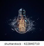 exploding light bulb on a dark... | Shutterstock . vector #422840710