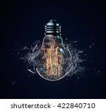 exploding light bulb on a dark... | Shutterstock . vector #422840710
