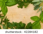 herbs in a border on wooden... | Shutterstock . vector #42284182