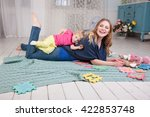 babies play with the nanny ... | Shutterstock . vector #422853748