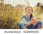 cheerful child girl in jeans... | Shutterstock . vector #422854243