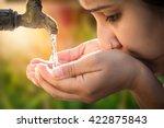 women drinking tap water in... | Shutterstock . vector #422875843