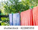 Stock photo clothespin hanging on washing line plastic washing line and clothespins on green nature background 422885353