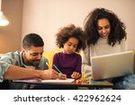 dad and son drawing while mom... | Shutterstock . vector #422962624