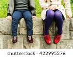 two pairs of kids feet wearing... | Shutterstock . vector #422995276