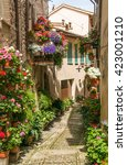Small photo of Beautiful alley decorated with flowers, Spello - Italy.