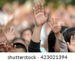 many hands raised in a crowd of ... | Shutterstock . vector #423021394