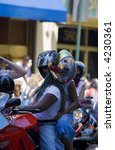 african-american women ride motorcycle on pride parade in New York - stock photo