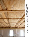 Small photo of Iinsulation of attic with fiberglass cold barrier and insulation material