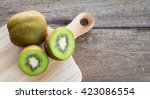 kiwi on wooden background. | Shutterstock . vector #423086554