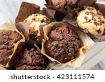 Chocolate Muffins In Wooden Bo...