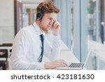 businessman in headphones... | Shutterstock . vector #423181630