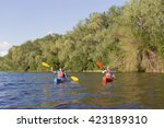 two guys travel the river on a... | Shutterstock . vector #423189310
