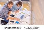 male and famale students busy... | Shutterstock . vector #423238804