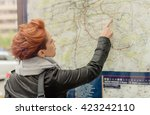 female tourist looking at big... | Shutterstock . vector #423242110