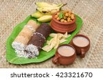 Small photo of Popular South Indian breakfast puttu / pittu made of ragi / finger millet flour and coconut in the bamboo mould / utensil, Kerala, India. Bamboo puttu.