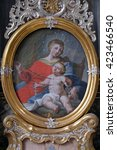 Small photo of URSBERG, GERMANY - JUNE 09: Virgin Mary with baby Jesus, altarpiece in the monastery church of St. John in Ursberg, Germany on June 09, 2015.