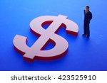 Us Dollar Sign And Miniature Men