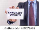 man showing paper with giving... | Shutterstock . vector #423529669