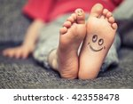 concept of kids feet with... | Shutterstock . vector #423558478