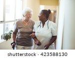 senior woman walking in the... | Shutterstock . vector #423588130