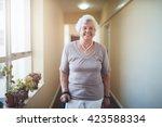 happy senior woman witportrait... | Shutterstock . vector #423588334