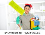 woman with cleaning supplies | Shutterstock . vector #423590188