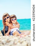 sisters on beach | Shutterstock . vector #423590404