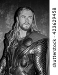 Small photo of AMSTERDAM, NETHERLANDS - May 5, 2016: Chris Hemsworth as Thor at the Amsterdam Madame Tussauds wax museum.