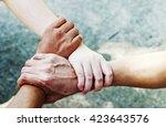 people hand assemble corporate... | Shutterstock . vector #423643576