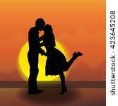 Couple Silhouette On Sunset...