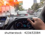the man hand driving car on the ... | Shutterstock . vector #423652084