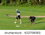 couple playing golf on green. ... | Shutterstock . vector #423708583