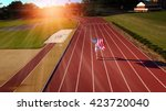 female athlete running with... | Shutterstock . vector #423720040