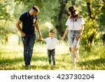 father  mother and son walking... | Shutterstock . vector #423730204