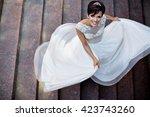 wedding. feeling weightless....   Shutterstock . vector #423743260