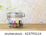 coins in a jar for travel  | Shutterstock . vector #423793114