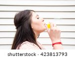 young woman blowing bubbles | Shutterstock . vector #423813793