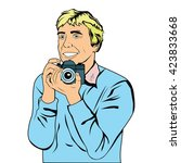 young man holds camera in his... | Shutterstock .eps vector #423833668