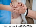 caring nurse holding old woman... | Shutterstock . vector #423860704