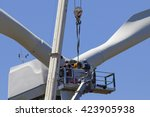 Wind Turbine Being Repaired ...