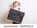 cute smiling schoolgirl in... | Shutterstock . vector #423940114