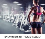 young sporty woman in the gym.... | Shutterstock . vector #423946030