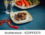 sweet dates  glass of drinking... | Shutterstock . vector #423993370
