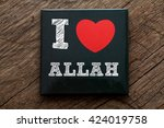 Small photo of I Love ALLAH written on black note with wood background