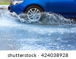 motion car rain big puddle of... | Shutterstock . vector #424038928