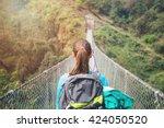 Hiker Girl Crossing Footbridge