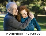 smiling senior couple embracing ... | Shutterstock . vector #42405898
