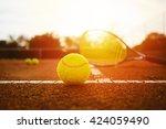 tennis equipment on clay court | Shutterstock . vector #424059490