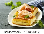 puff pastry pies with red pesto ... | Shutterstock . vector #424084819